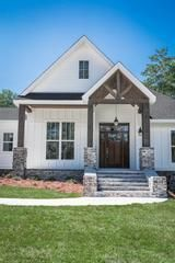 This contemporary craftsman home offers three bedrooms with a private master suite including a spa-like bath and generous master closet.