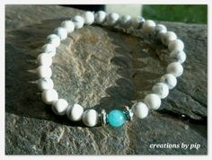 Check out this item in my Etsy shop https://www.etsy.com/uk/listing/333524922/white-turquoise-howlite-and-amazonite