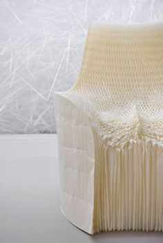 tokujin yoshioka - the chair is made from honeycomb glassine paper that moulds to the sitter, transforming over time