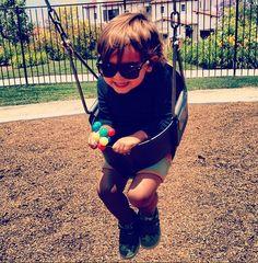 mason having fun on the swings!