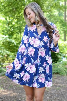 Bold prints? Yes please! By blu pepper, this navy colored classic swing dress features a pink and sand colored floral print that definitely makes you say 'wow.' Everytime you slip on this gorgeous num