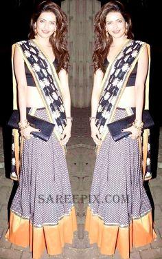 Hindi TV actress Karishma tanna in half and half saree. She is beautiful in designer half saree. One side swept hairstyle finished her look. Bridal Lehenga, Lehenga Choli, Sarees, Saree Backless, Side Swept Hairstyles, Embroidery Saree, She Was Beautiful, Half Saree, Bollywood Fashion