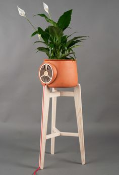 Aeris is an air purifier, the flow of air is increased into the plant, forcing the air to go through clay to activate carbon, which then purifies the surrounding air.