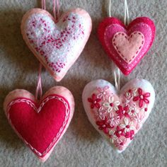 Pink and white embroidered felt heart ornaments