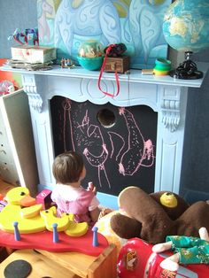 Chalkboard art display in child's room...if you happen to have a non working fireplace in there....
