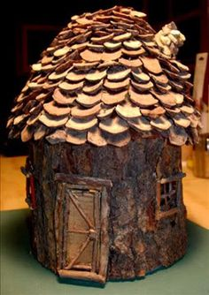 fairy house from oatmeal container, bark, pinecones--this link does not give specific instructions-- looks like the roof shingles are from the pinecone scale(leaf), bark for sides and twigs for windows and door : )