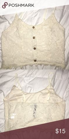 Crop top Lacey cream pastel crop top! Casual, with a touch of fancy. Great for parties or festivals! One of my favorites. Size small, with adjustable straps Paper Crane Tops Crop Tops