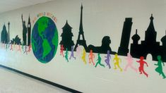At Alcova Elementary in Dacula, GA, students will be ready to travel the world a. At Alcova Elementary in Dacula, GA, students will be ready to travel the world as soon as they walk down the hallway to their classrooms! Elementary Classroom Themes, Classroom Door, Classroom Design, School Classroom, Geography Classroom, World History Classroom, School Hallways, School Murals, Around The World Theme
