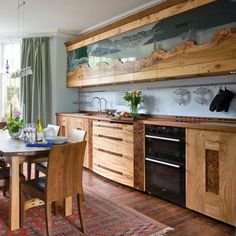 Love those cabinet doors and natural wood!