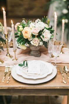 Wedding Inspiration Designed to Stand the Test of Time. Love the pink candles elegant flower centerpiece