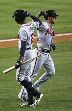 Dan Uggla #26 of the Atlanta Braves is greeted by  B.J. Upton #2 after hitting a solo home run in the fifth inning against the Los Angles Dodgers at Dodgers Stadium