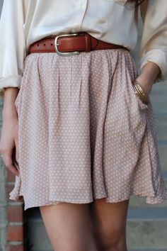 Tucked in blouse + skirt. I'd like this with tights and tall boots.