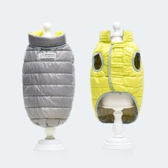 Duvet Jacket 2 in 1 Yellow-Grey  Colourful or quiet? Whatever your mood calls for this double-sided jacket makes a clear statement about your pet. The reversible down jacket has no sleeves and comes with a small neck band and a Velcro fastener for optimal fitting to suit your pet.