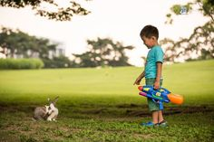 Bunny Friend - A curious boy looks at an unfamiliar site. As the bunny itches his nose, a cautious boy approaches.