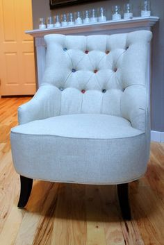 Tufted chair with various kinds/colors of buttons. Don't love this chair design but this colorful tufting concept would be pretty for a bedroom.
