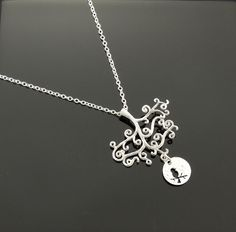 Matte Silver Tree and Bird Necklace. Tree by SimpleElegantJewelry, $20.00