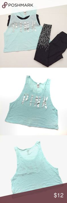 PINK MUSCLE TEE WITH SILVER LETTERS & RHINESTONES I'm selling this lovely light baby blue  muscle tee with wide opening on arms. It's perfect to throw on top of your sports Bra, a cute sexy bra or your bathing suit. It's in good condition. Used a couple of times, but there is a small faded spot. See pictures. Priced accordingly. I wear small, but this is a large because I liked the oversized look with the leggings for working out. 💖BUNDLE AND SAVE MORE 💖 PINK Tops Muscle Tees