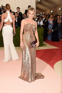Pin for Later: Can You Guess Hollywood's Favorite Label of the Year? Sienna Miller There's no better place than the Met Gala to debut a column of gold sparkles. Sienna swept up her hair to reveal the bow detail on her bodice.