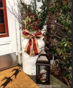 Outdoor Christmas decor, front door decor, Add a holiday touch to your milk can! #rustic #milkjug #burlap #lanterns #welcomemat