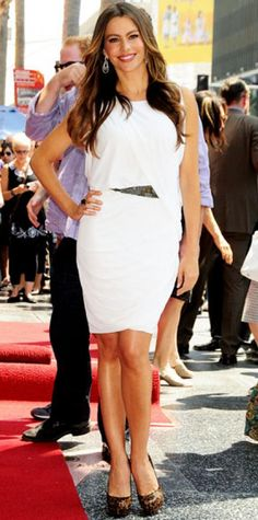 Look of the Day › August 31, 2011 WHAT SHE WORE Sofia Vergara sizzled in a draped LWD, Adeler jewelry and sky-high Louboutins on the Hollywood Walk of Fame. WHY WE LOVE IT The Colombian beauty looked more like a Greek goddess in a toga-inspired design. A beaded waistline and leopard print pumps upped the glam factor of the actress's relaxed silhouette.