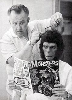 Unidentified Ape and Unidentified Barber reading.