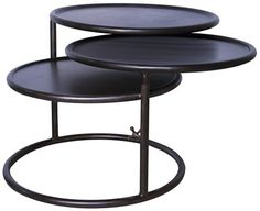 Baxter Side Table - How cool is this? This Black Metal table extends from and end table to a coffee table. Each rounded layer can spin around to wherever you need it to be.
