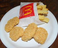 April Fools chicken nuggets (Parents 4/2007) Cut & shape banana slices into nuggets, cover w creamy PB, then coat w crushed honey grahams, serve with whisked seedless strawberry preserves.