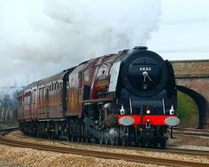 """Former LMS (London, Midland and Scottish) Stanier Pacific Loco no. 6233 """"Duchess of Sutherland"""" steams past Monk Fryston, Yorkshire"""
