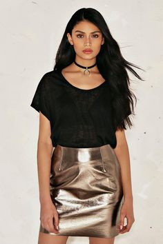 Let it shine. The Bethany Skirt features a vegan leather shell, mini length, and metallic finish.
