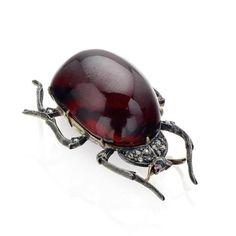 A 19th century garnet beetle brooch.