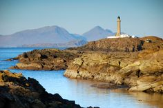 Ardnamurchan Lighthouse, Scotland, with the islands of Muck and Rum beyond, by Jamie Glenday.