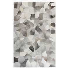Bring rustic-chic appeal to your living room or parlor with this hand-stitched cowhide rug, showcasing an abstract patchwork motif.
