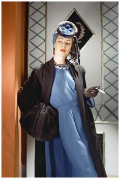 Standing model with cigarette, wearing brown wool coat, blue wool dress, nutria hat, and huge nutria muff Horst P. Horst 1941 - curated by Dior Haute Couture, 1940s Costume, Christian Lacroix, Brown Wool Coat, Saab, Valentino, Vintage Fashion Photography, Moda Vintage, Vintage Couture