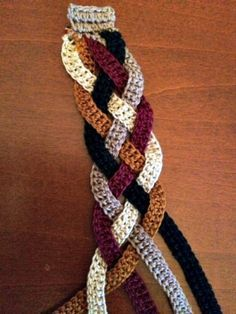 Scale down a crochet scarf to make a crochet bracelet. This is a really cute crochet project idea! I love the colors in this crochet jewelry project.