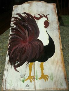 Hand painted rooster on reclaimed fence board.