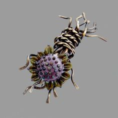 Brooch | Cyndie Smith. 'Nature Lover's' Brass wire and a Patty Lakinsmith lampwork bead.