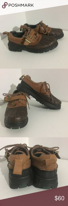 Polo Hiking Boots These are new never worn. Polo Sport leather low rise rain/ winter boots. Great deal! These retail at over $100! These are a men's 6.5 or a women's size 8. Pull strap on the back came part on one side but is still attached. Polo by Ralph Lauren Shoes Boots