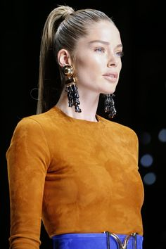 Balmain: The High Ponytail - The I Dream of Jeannie–esque updo has never gone out of style, but Balmain's version—paired with bronzed, sculpted cheekbones, statement earrings, and fierce girl-squad confidence—was born for an up-all-night dance party.