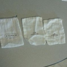 3 Small Coach Dust Bags 3 Small Coach Dust Bags. One has a brown tie a string and the other to have white strings they are small in picture 2 you can see that they're only the size of my hand will separate just comment on the post thank you for shopping in my closet comes from a smoke free clean home Coach  Other