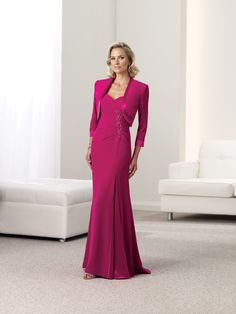 Two-piece silky crepe suit, sleeveless A-line dress with gathered shoulder straps, sweetheart neckline, side gathered bodice accented with hand-beaded appliqué, skirt with side gathered inset and sweep train, matching bolero jacket with three-quarter length sleeves. Sizes: 4 – 20