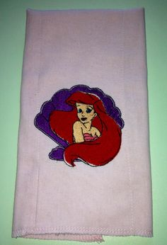 Ariel from the little mermaid burp cloth (can be done on anything!) $12 without a ruffle and $14 with. So cute  Find us on Facebook! SewCuteChics