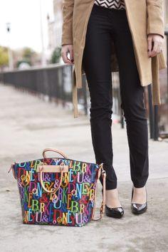 dooney and bourke handbag, neutral coat, black pants, black pumps