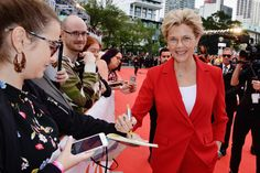 """Annette Bening signs an autograph at the """"Life Itself"""" premiere during the 43rd Toronto International Film Festival - September 8, 2018."""