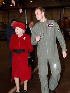 Queen Elizabeth II is escorted by her grandson Prince William during a visit to RAF Valley where Prince William is stationed as a search and rescue helicopter pilot on April 1, 2011 in Holyhead, United Kingdom.