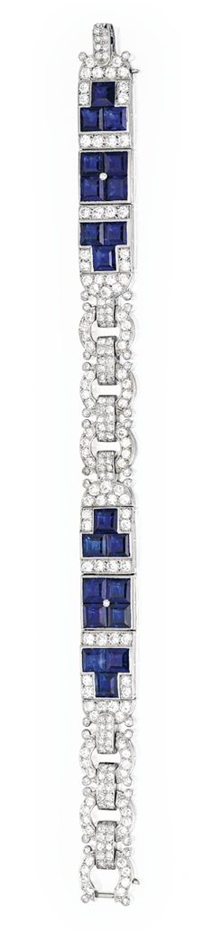 PLATINUM, SAPPHIRE AND DIAMOND BRACELET, CARTIER.  Set with 20 square-cut sapphires, accented by old European and single-cut diamonds weighing approximately 6.60 carats, length 7 inches, signed Cartier, numbered 4392; circa 1925.
