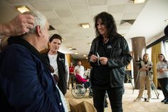 Alice Cooper Photos Photos - Alice Cooper helps a patient of the Starkey Hearing Foundation at Four Season Hotel Ritz Lisbon on May 27, 2016 in Lisbon, Portugal. - Starkey Hearing Foundation Hearing Mission With Hollywood Vampires - Rock in Rio Lisboa 2016