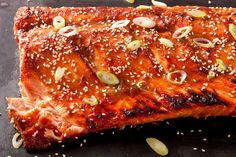 Miso-Ginger Glazed Salmon Scaled down for 2: 2 T mirin  2 T red miso paste 1 T packed light brown sugar 1 T soy sauce 1/2 tablespoons peeled and grated fresh ginger (from about a 1/2-inch piece) 2 6oz Salmon fillet, skin on and pin bones removed 1 medium scallion, thinly sliced (white and light green parts only) 1 teaspoons white sesame seeds, toasted