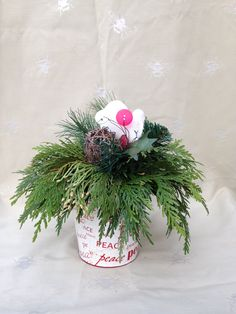 Use a container that has some unique feature to add to your arrangement Sprays, Christmas Wreaths, Container, Texture, Holiday Decor, Unique, Color, Home Decor, Surface Finish