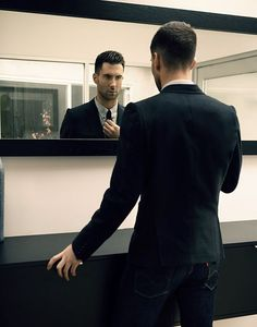 Adam Levine checking himself out in the mirror before show