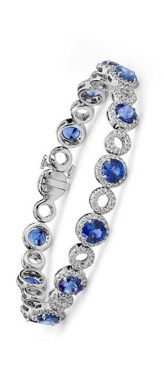 I want a blue diamond bracelet that matches my wedding ring/earrings/necklace. Round, blue stone with diamonds around. Basket set only, no channel set. ~AAA Blue Sapphire and Open Circle Pavé Diamond Bracelet in 18k White Gold | Something Blue